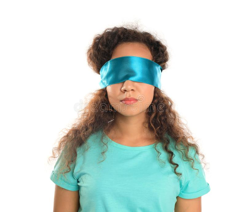 Young African-American woman with light blue blindfold royalty free stock photo