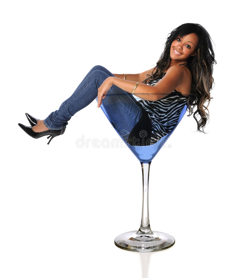 Young African American Woman in Martini Glass. Portrait of beautiful African American woman in martini glass isolated over white background stock images