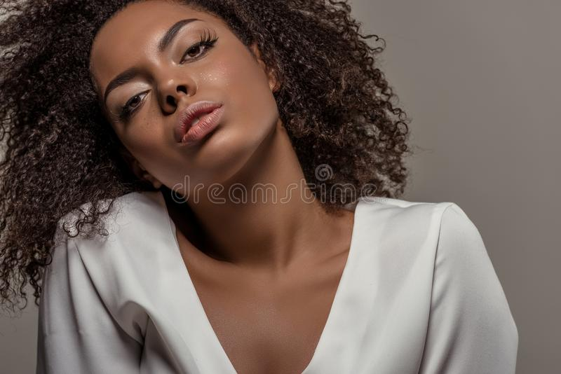Young african american woman with seductive look in white shirt stock photos