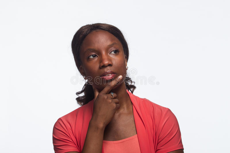 Young African American woman thinking, horizontal royalty free stock photo