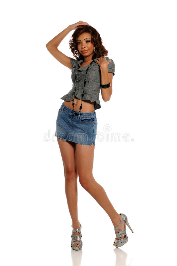 Young African American Woman wearing a mini skirt stock images