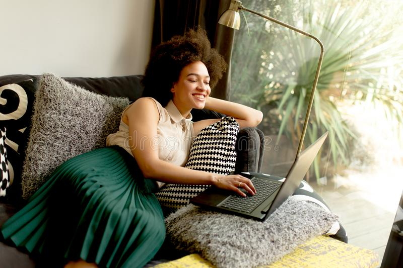 Young African American Woman Web-surfing Internet Stock ...