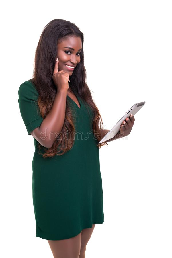 African business woman at work. Young african business woman working with a laptop pc, isolated over white stock photography