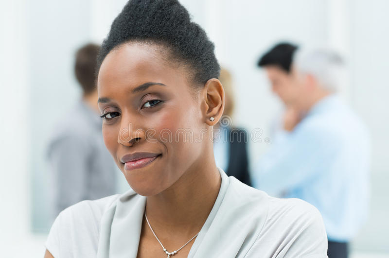 Young African Businesswoman. Portrait Of Young African American Businesswoman In Her Office royalty free stock photos