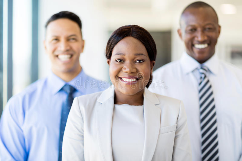 Young african businesswoman team. Beautiful young african businesswoman with business team stock image