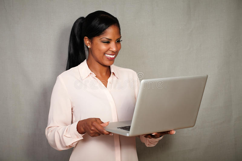 Young african businesswoman using a laptop stock images