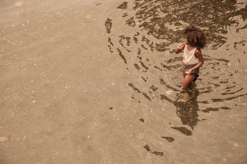 A young african child bathing in the local river royalty free stock photo