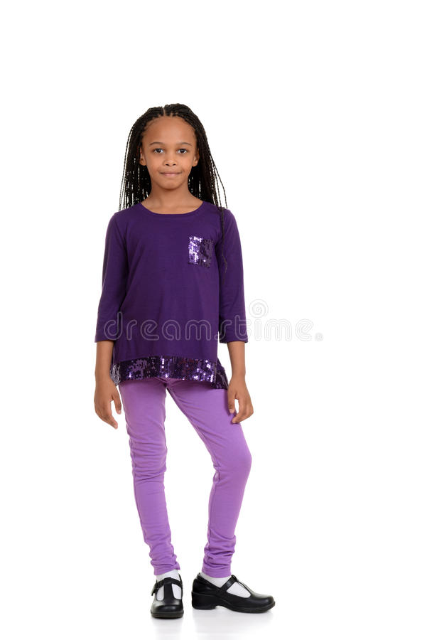 Young african child wearing purple outfit stock images