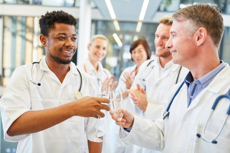 Young african doctor celebrates passed exam royalty free stock photography
