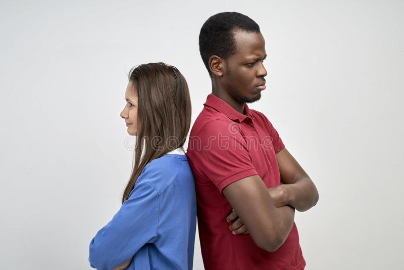 A young African and European couple stand royalty free stock photo
