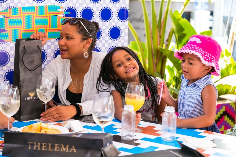 A young African family enjoying a day out at a Food and Wine Fair drinking and generally enjoying a day out at a Food and Wine. Johannesburg, South Africa royalty free stock photography
