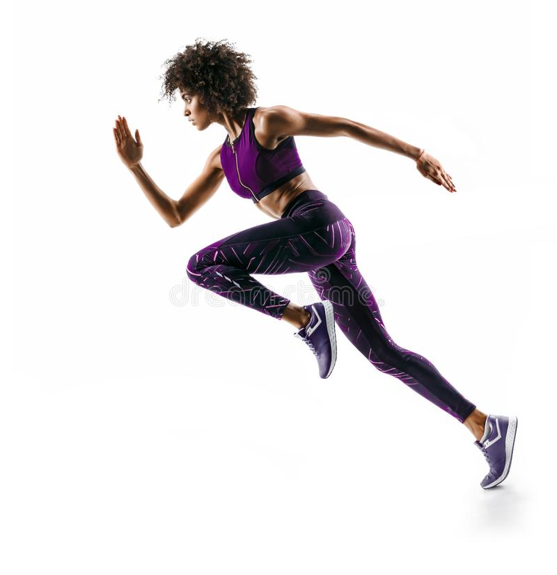Young african girl running in silhouette. On white background. Dynamic movement. Side view stock image