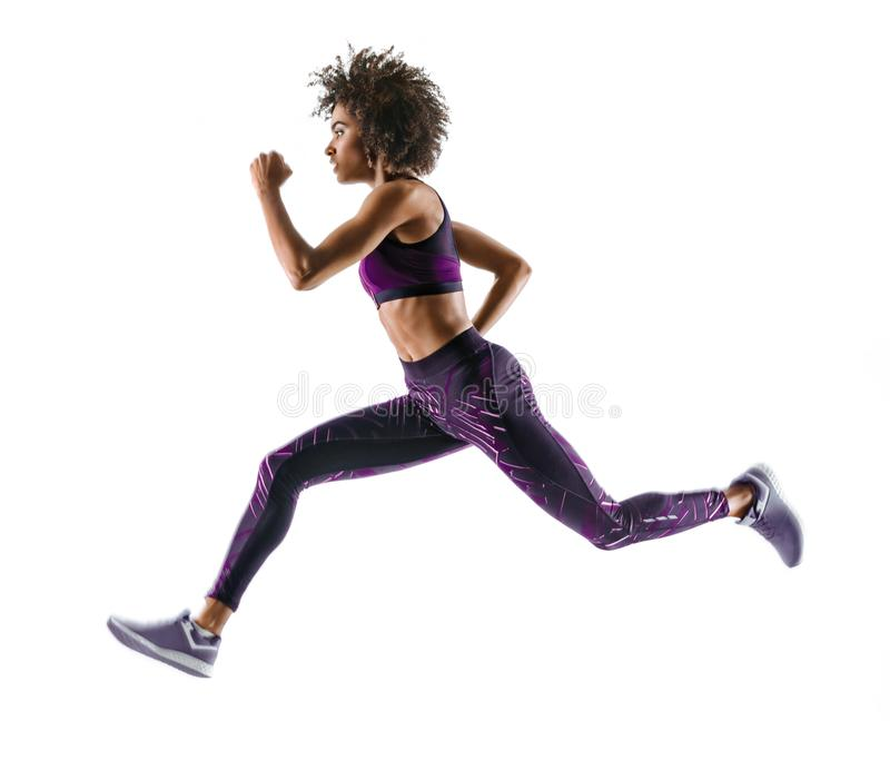 Young african girl running in silhouette on white background. Dynamic movement. Side view royalty free stock image