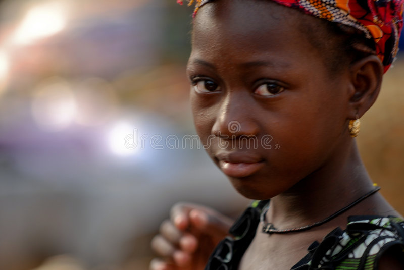 Young african girl w/ earring royalty free stock photo