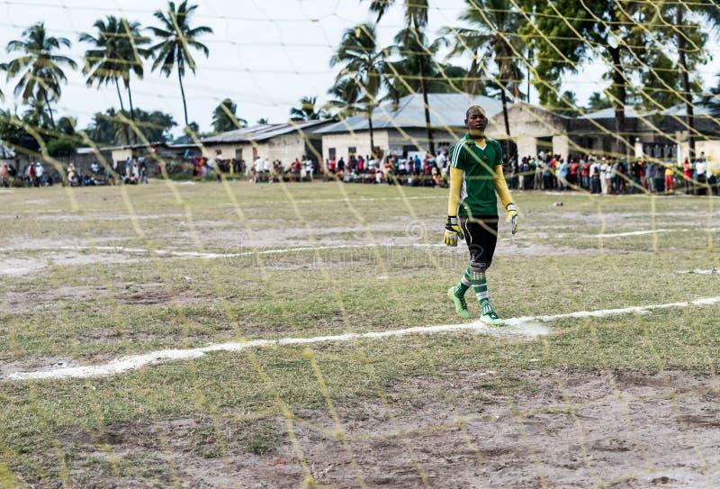 Young african goalkeeper on football field in Zanzibar stock photo