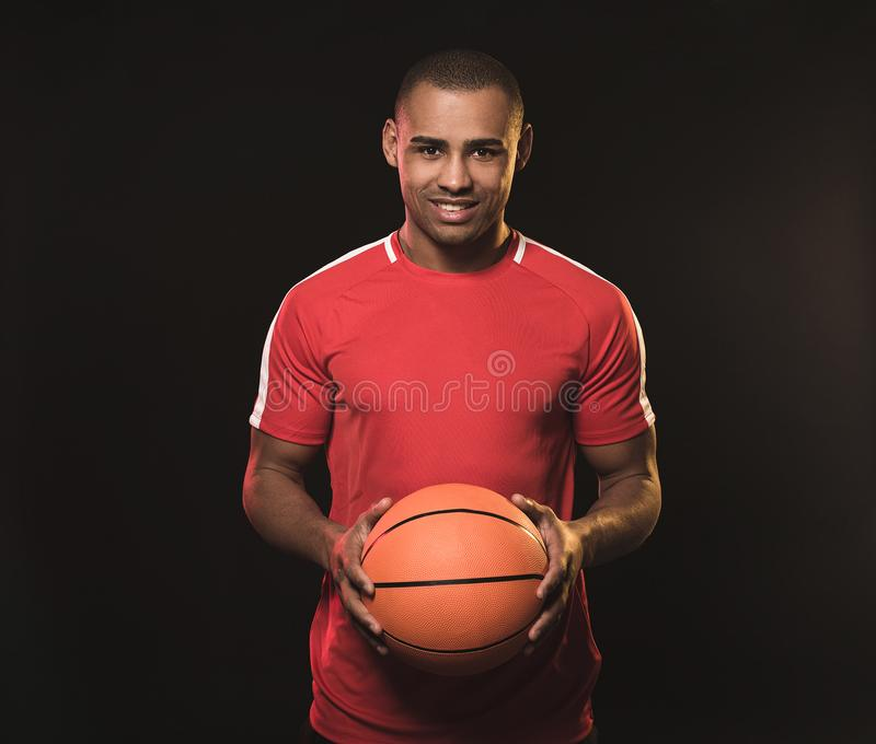 Young african man with ball royalty free stock photography