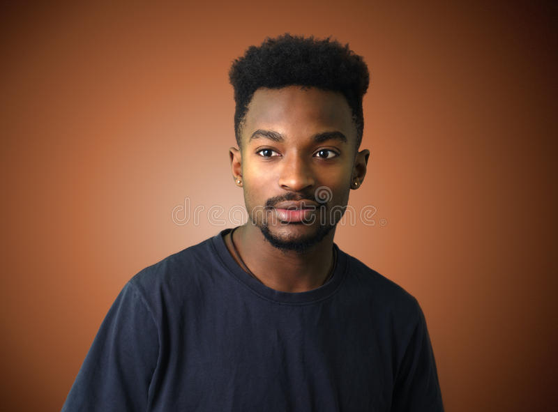 Young african man portrait brown gradient background royalty free stock photos