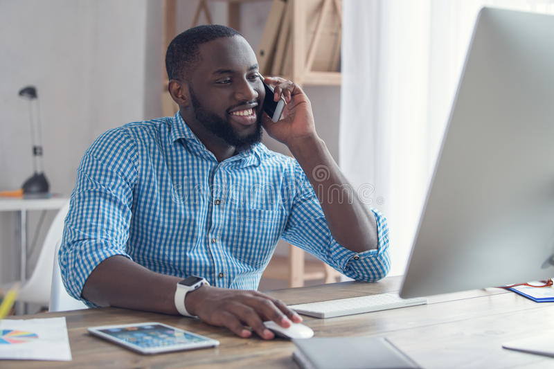 Young african man working in the office business stock image