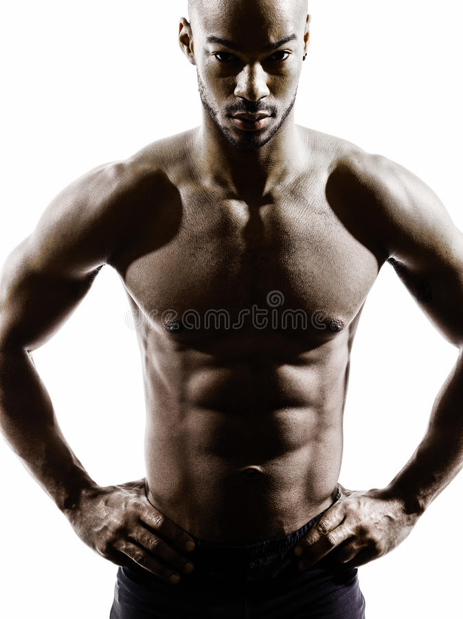 Young african muscular build man topless silhouette stock image