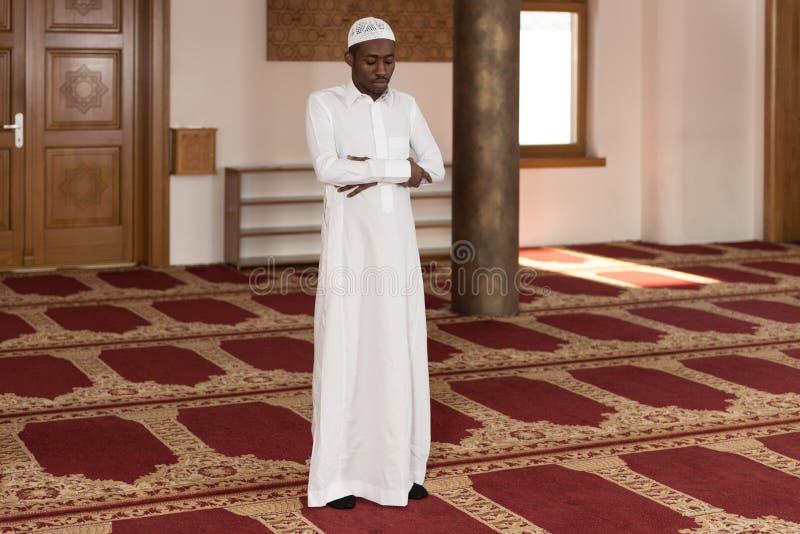 Young African Muslim Guy Praying royalty free stock photos