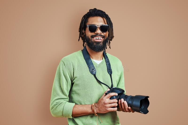 Young African photographer in casual clothing royalty free stock photo