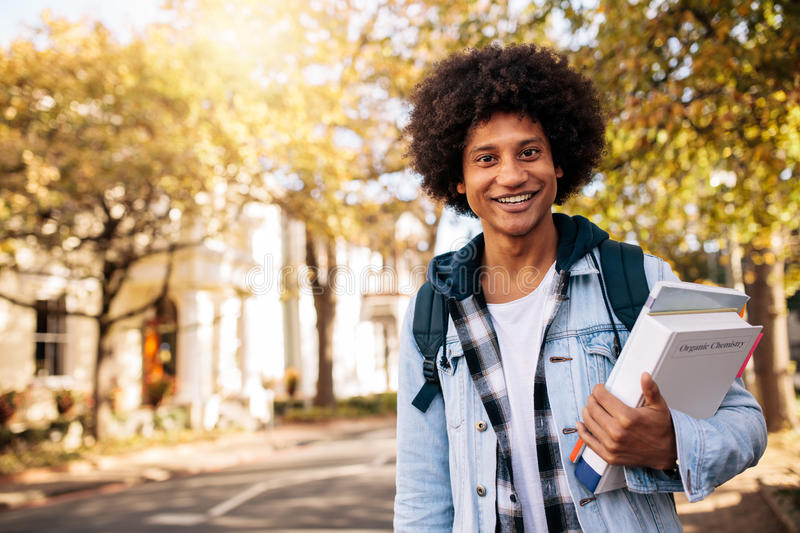 Young african student returning from college royalty free stock photography