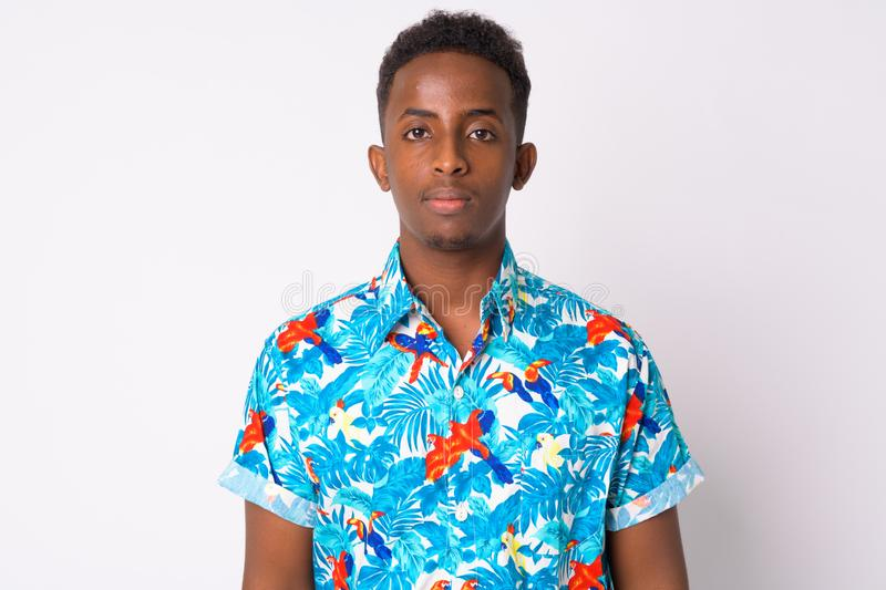 Young African tourist man with Afro hair. Studio shot of young African tourist man with Afro hair against white background royalty free stock photos