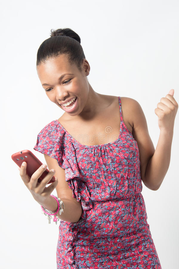 Young African woman excited over text message royalty free stock image