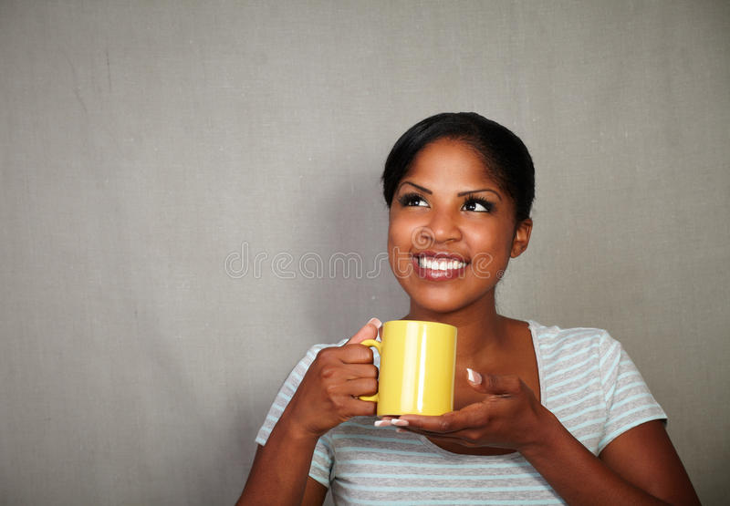 Young african woman holding a tea cup stock images