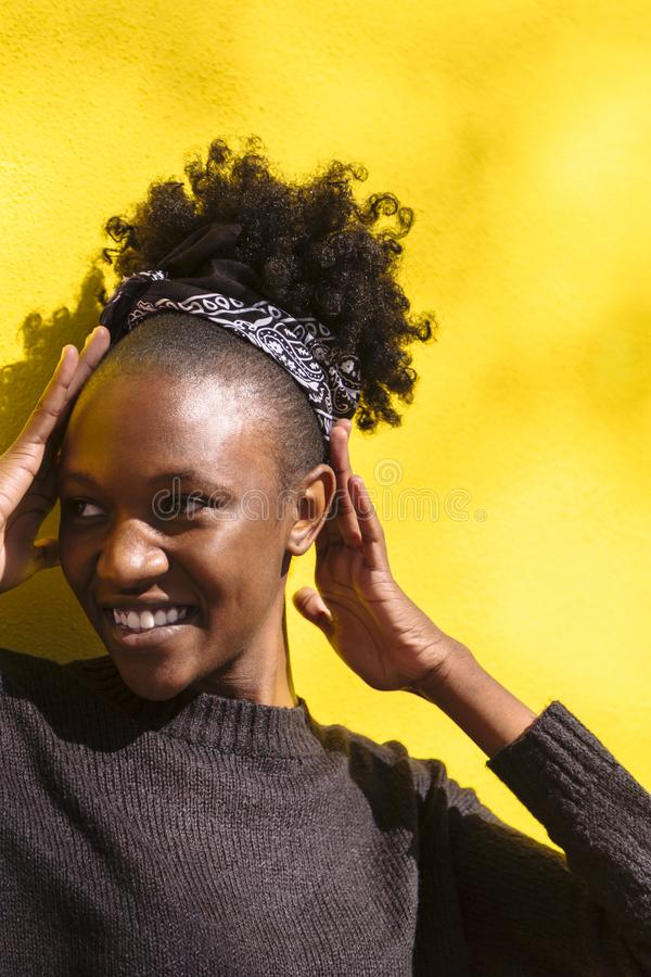 Young african woman looking at camera and smiling royalty free stock photos