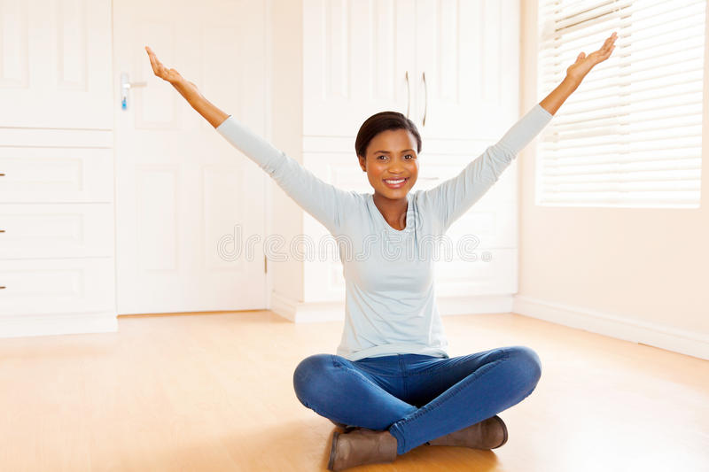 young african woman sitting stock photos