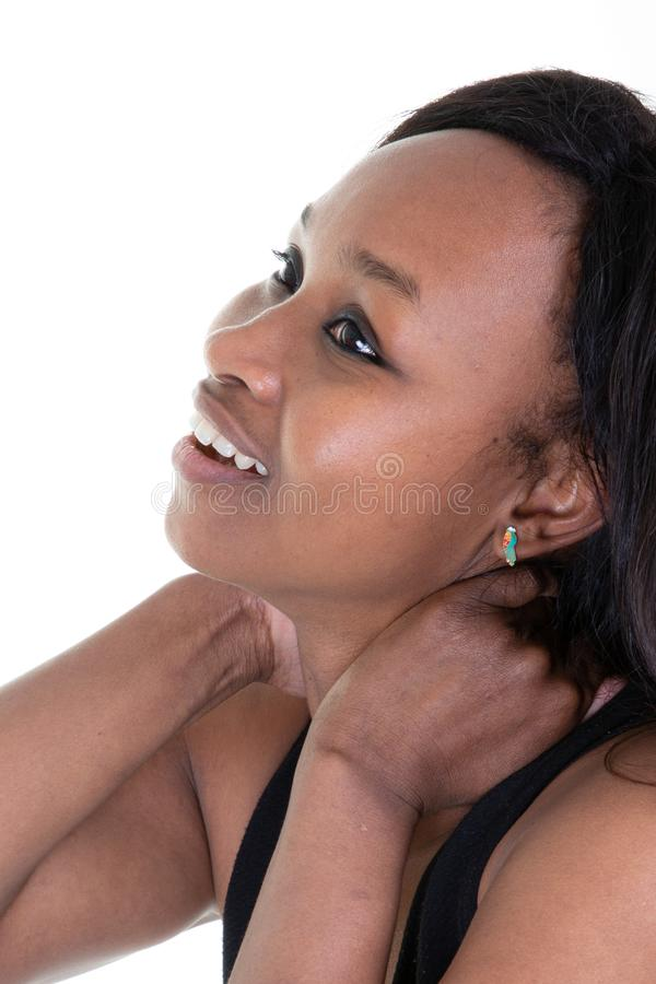 Young african woman suffering from neck pain sense of fatigue exhausted stressed girl massages painful neck with hands in concept royalty free stock image