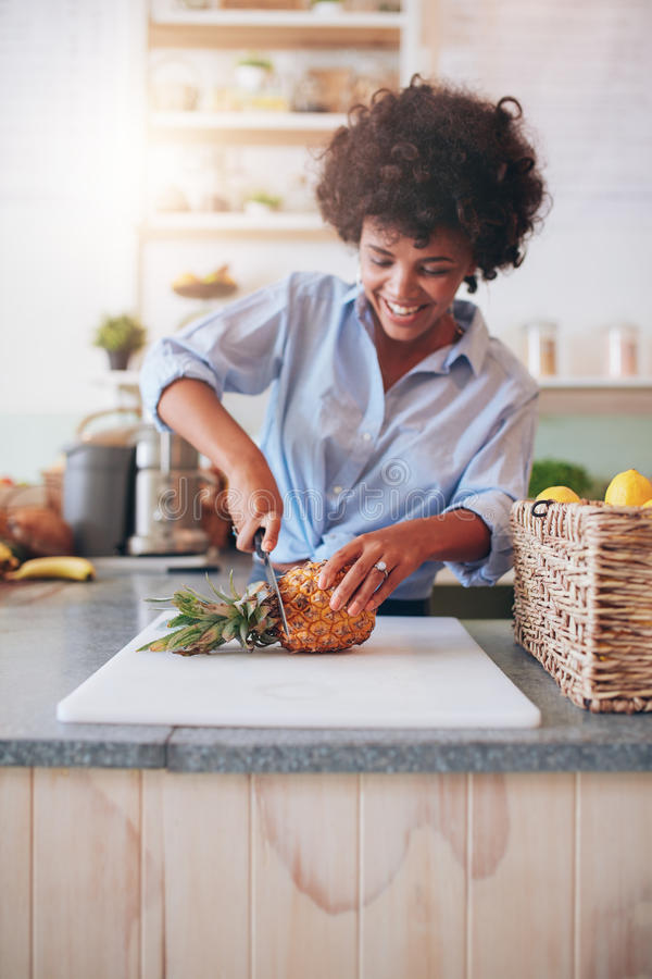 Young african woman working at juice bar stock images
