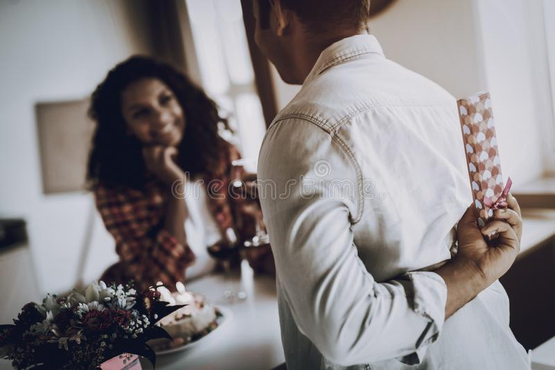 Young Afro American Couple Date. Present Concept. stock images