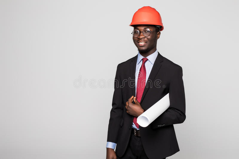 Young Afro-American engineer with blueprints on white background stock photo