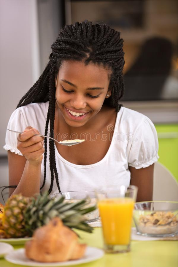Young female having breakfast stock photo