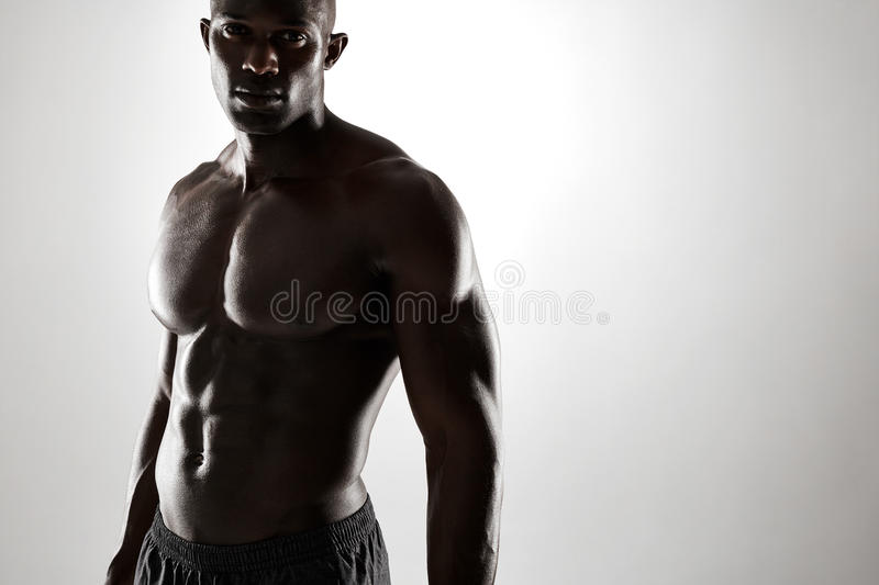 Young afro american man with muscular physique royalty free stock images