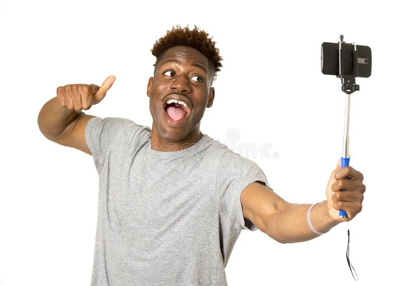 Young afro american man smiling happy taking selfie self portrait picture with mobile phone stock image