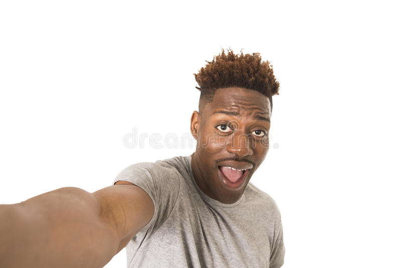 Young afro american man smiling happy taking selfie self portrait picture with mobile phone royalty free stock images