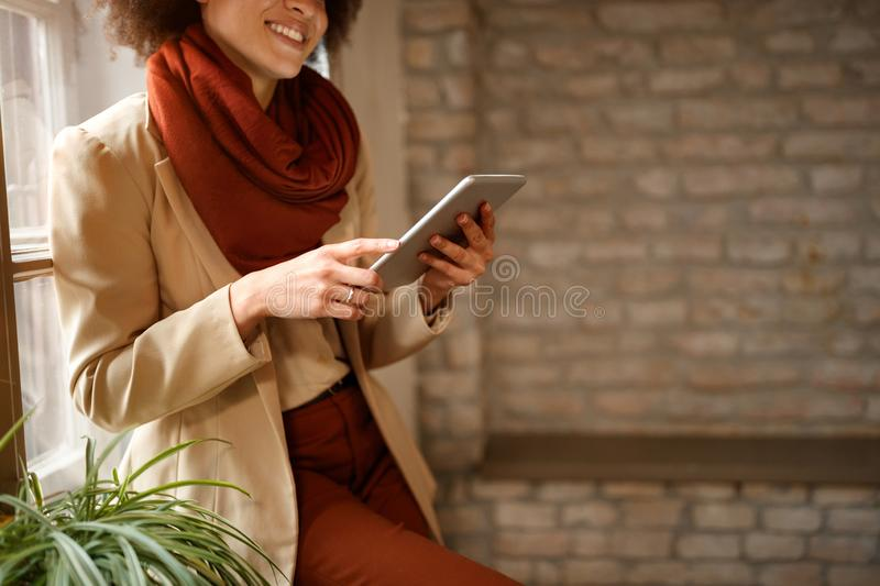 Girl looking surfing internet on iPad royalty free stock image