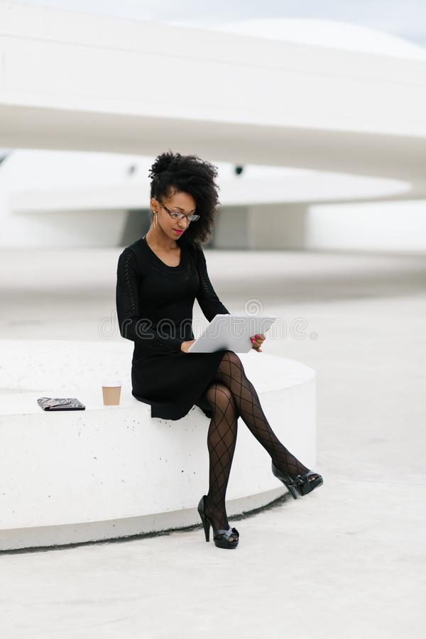 Stylish young afro hair professional woman using tablet royalty free stock images