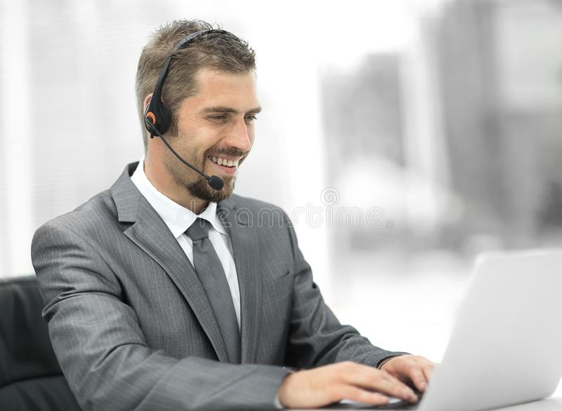 Young agent of the call center with the headphones. stock photo