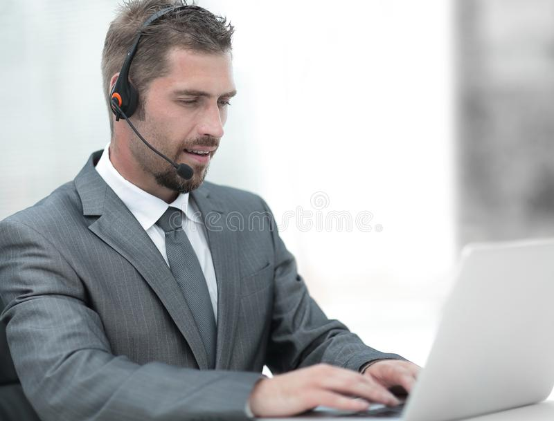 Young agent of the call center with the headphones. royalty free stock photos