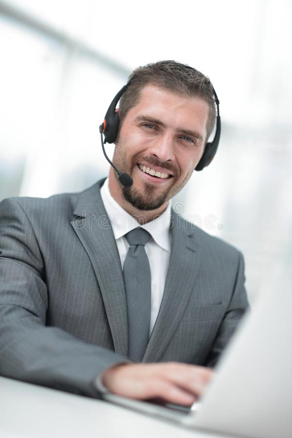 Young agent of the call center with the headphones. royalty free stock image