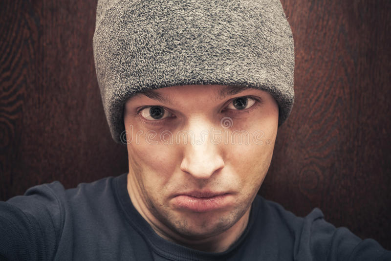 Young agressive Caucasian man face stock photo