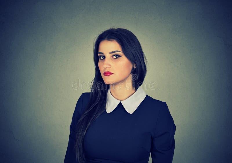 Serious beautiful woman in dress stock photo