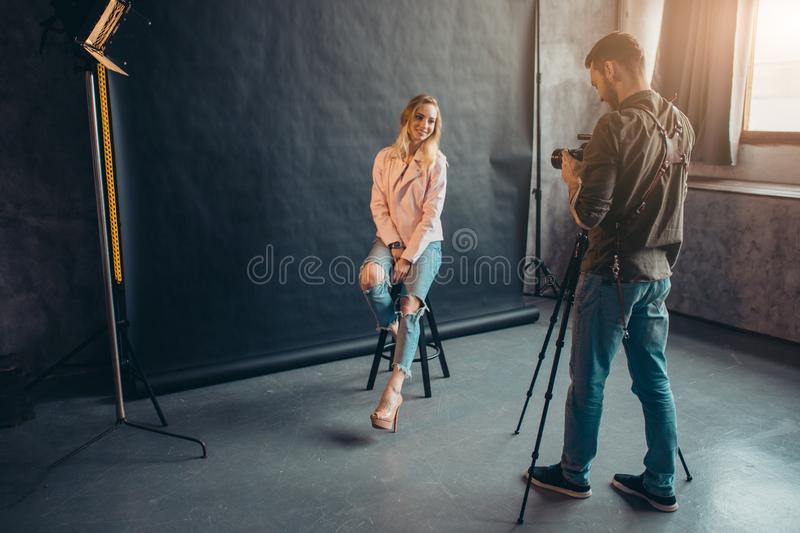 Young ambitious girl having an important photo session stock images