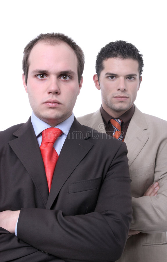 Young and ambituous businessmen. Young and ambitious businessmen portrait isolated on white - focus on left person royalty free stock photo