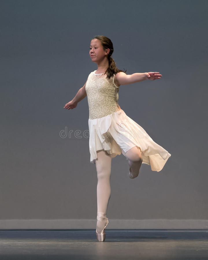 Young Amerasian girl in a ballet performance royalty free stock images