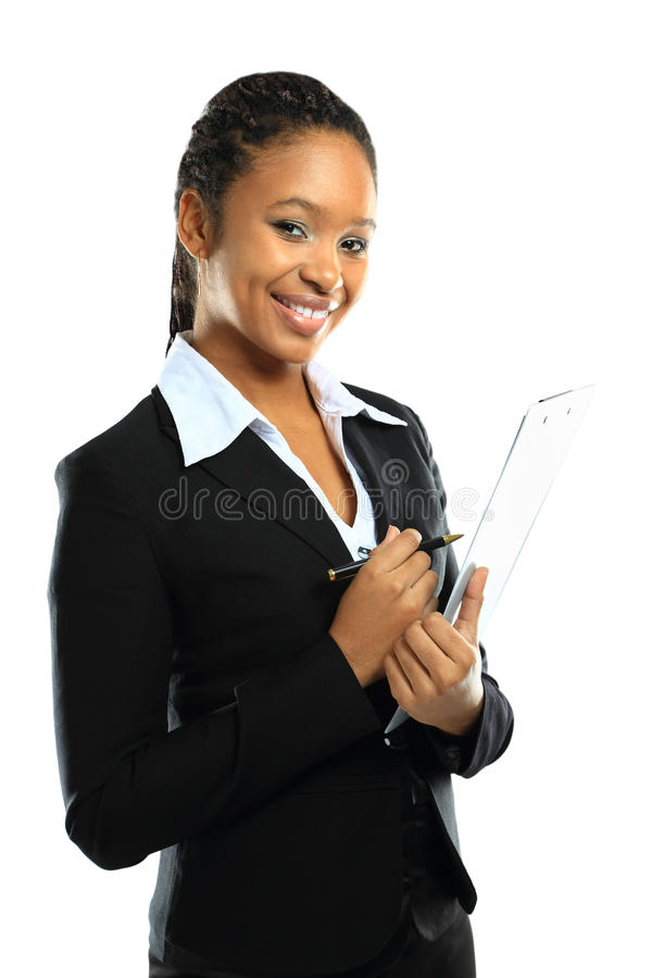 Young american african business woman. Portrait of an attractive young american african business woman with clipboard royalty free stock images
